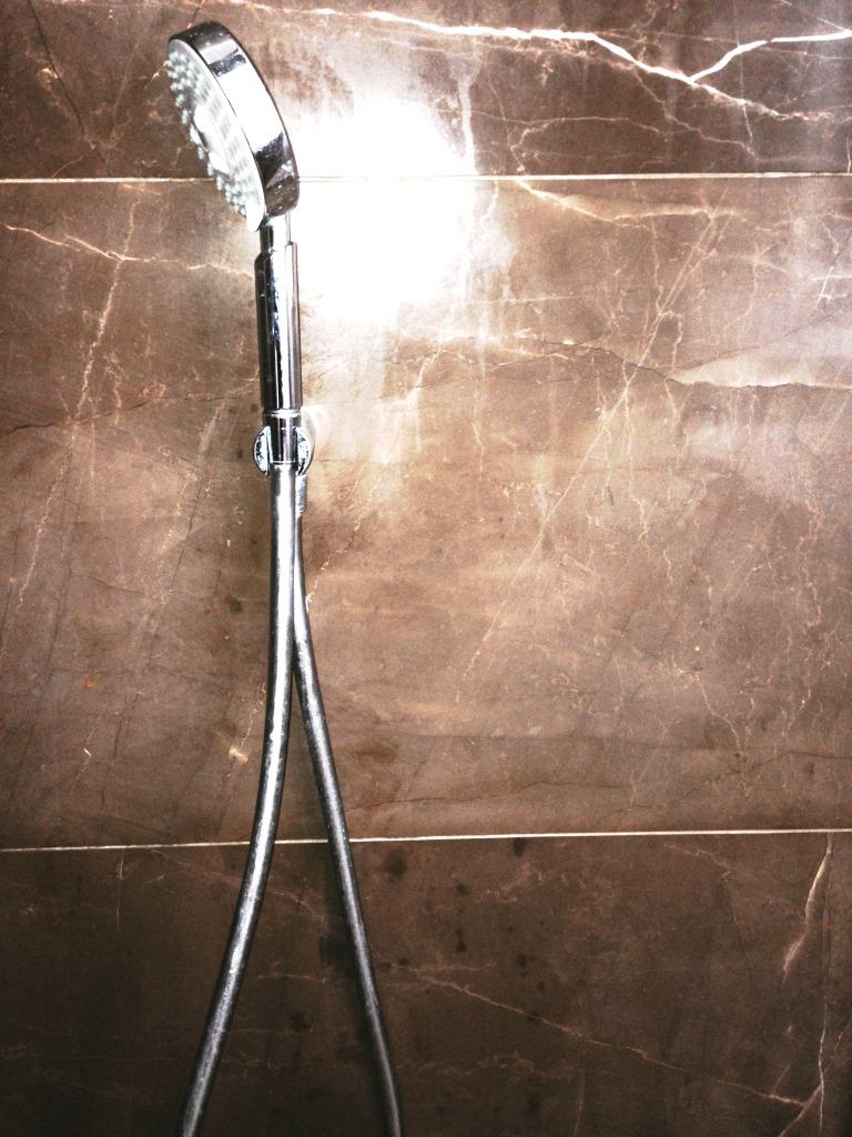 Damaged Marble Shower Tiles in Woodmancote After