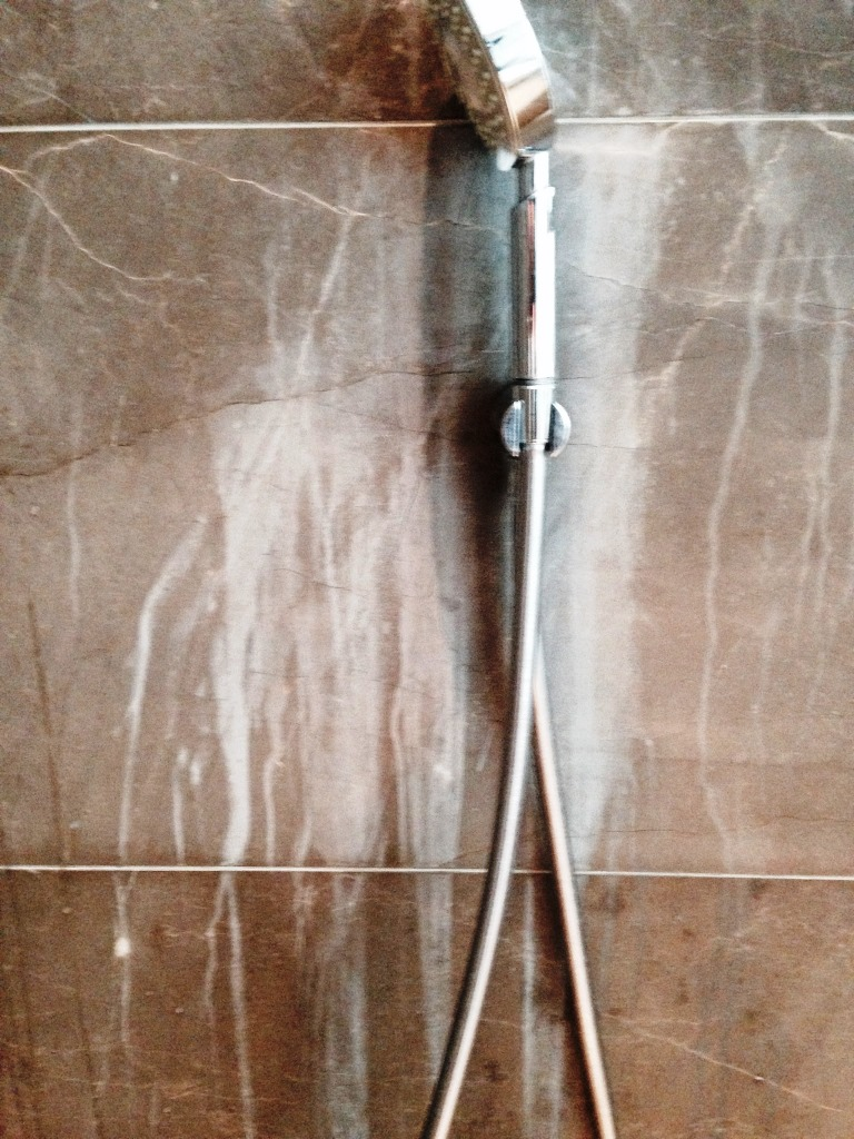 Damaged Marble Shower Tiles in Woodmancote Before